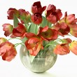 Stock Photo: Bouquet of Red Tulips in Cristal Vase
