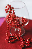 A goblet with red beads — Stock Photo