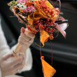 Bride holding wedding flowers bouquet — Stock Photo #6933328