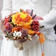 Bride holding wedding flowers bouquet — Stock Photo #6952044