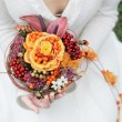 Bride holding wedding flowers bouquet — Stock Photo