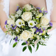 Bride holding wedding bouquet — Stock Photo