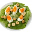Cut eggs on lettuce - Stock Photo