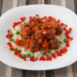 Meatballs with tomato sauce and rice with peas — Stock Photo