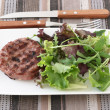 Grilled hamburgers with salad - Stock Photo