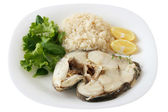 Boiled fish with rice and lemon — Stockfoto