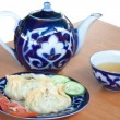 Uzbek Dumplings - mandu and teapot with cup — Stock Photo