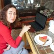 Young attractive womsitting in cafe with laptop — Foto de stock #6955133