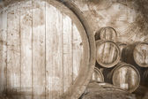 Old wine casks in vintage stile, background — Stock Photo