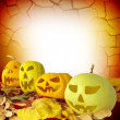 Halloween Pumpkin on fall leaves — Stock Photo