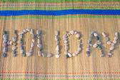 Parola di vacanza fatta di ciottoli — Foto Stock