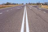 Simbolo di freccia traffico sulla strada — Foto Stock