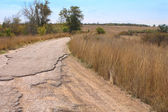 Cracked rural road — Stock Photo