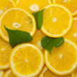 Slices of citrus fruit, background — Stock Photo