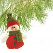 Cute snowman under a pine tree isolated on white — Stockfoto