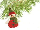Cute snowman under a pine tree isolated on white — Stock Photo