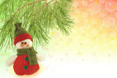 Cute snowman under a pine tree — Stock Photo