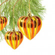 Christmas balls – hearts on pine tree branch isolated on white — Stock Photo