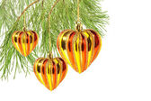 Christmas balls – hearts on pine tree branch isolated on white — Стоковое фото