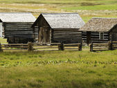 Rustic log cabin on the farm — Stock Photo