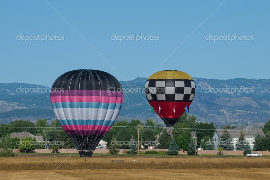Hot air balloons in a field during a festival in Loveland, Colorado. — Stock Photo #6840573
