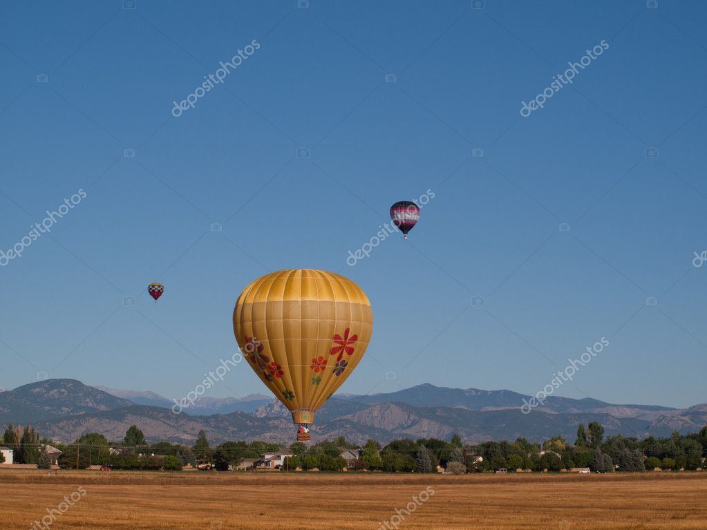 Hot air balloons in a field during a festival in Loveland, Colorado. — Stock Photo #6840640