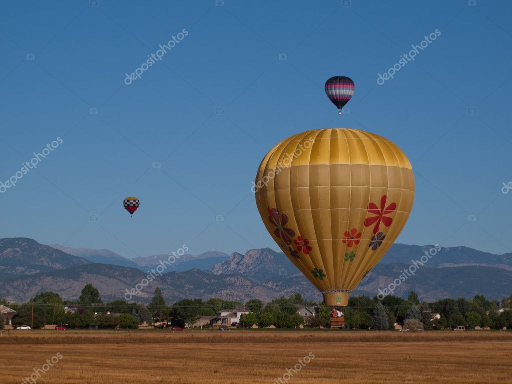 Hot air balloons in a field during a festival in Loveland, Colorado.  Stock Photo #6840680
