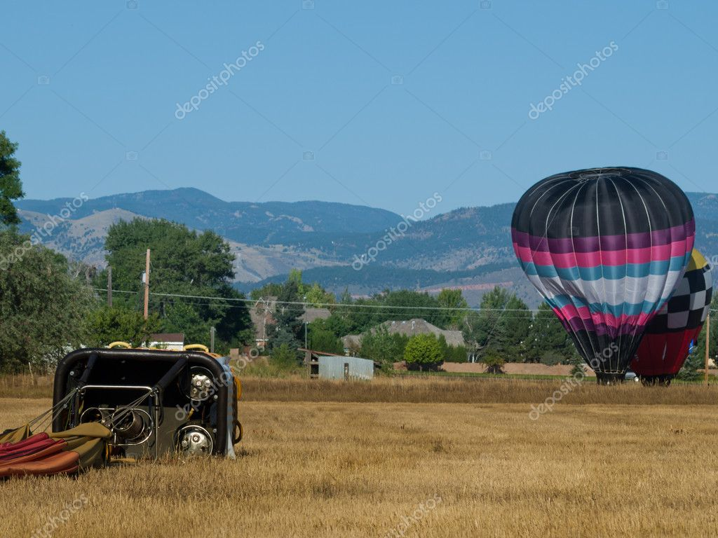 Hot air balloons in a field during a festival in Loveland, Colorado.  Stockfoto #6840751