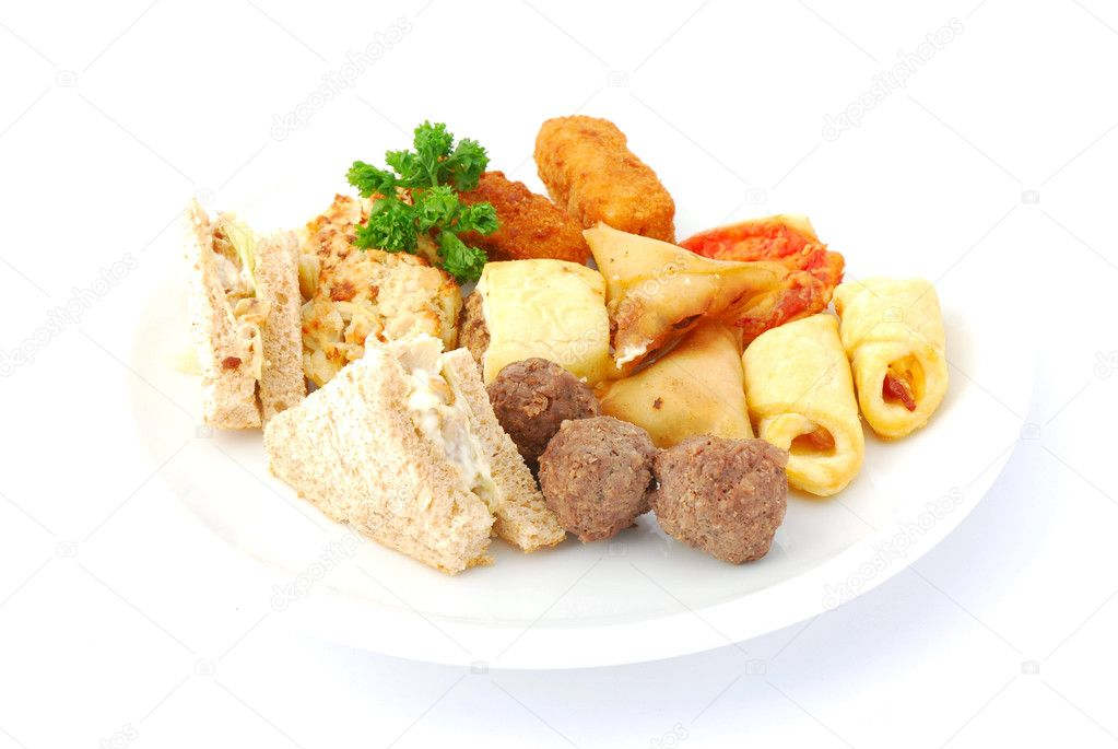 A big plate full of delicious savory party snacks. Image isolated on white studio background. — Stock Photo #6748342