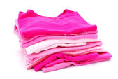 Stack of girls clothes — Stock Photo