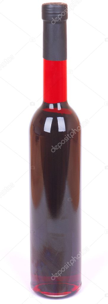 A long slim closed bottle filled with delicious red liqueur. Image isolated on white studio background. — Stock Photo #6857182