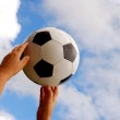Soccer ball in hands — Stock Photo