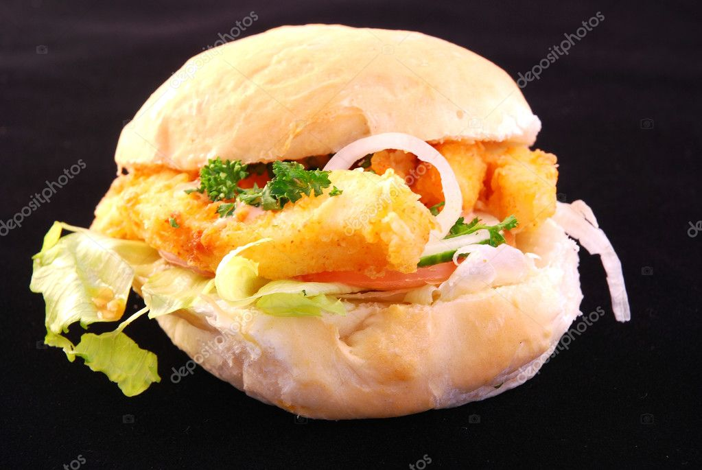 Closeup of a colorful fresh and appetizing Calamari Burger. Image isolated on black studio background. — Stock Photo #6885064