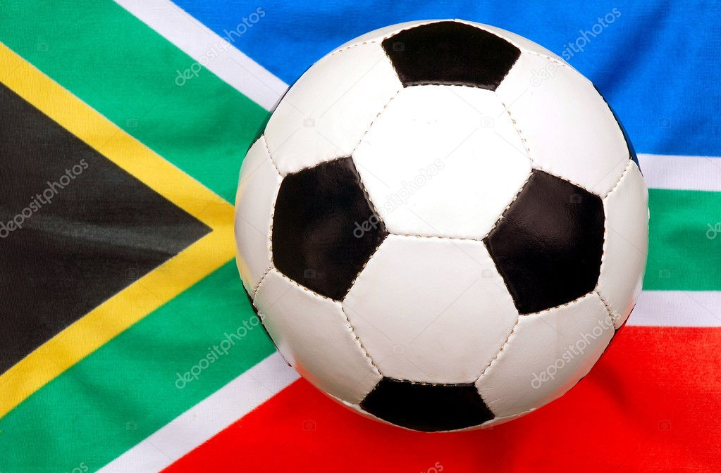 A traditional black and white soccer ball on national flag background of the rainbow nation South Africa - the host country of the football world cup in 2010. — Stock Photo #6886749