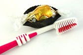 Tooth brush and chocolate — Stock Photo
