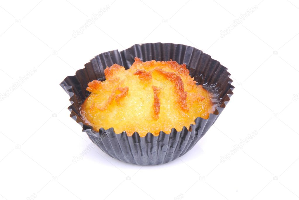 A single freshly baked cupcake with delicious coconut flavor. Image isolated on white studio background.  Stock Photo #6951873