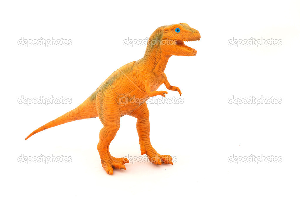 An orange used dinosaur toy for kids to play with. Image isolated on white studio background. — Stock Photo #6956834