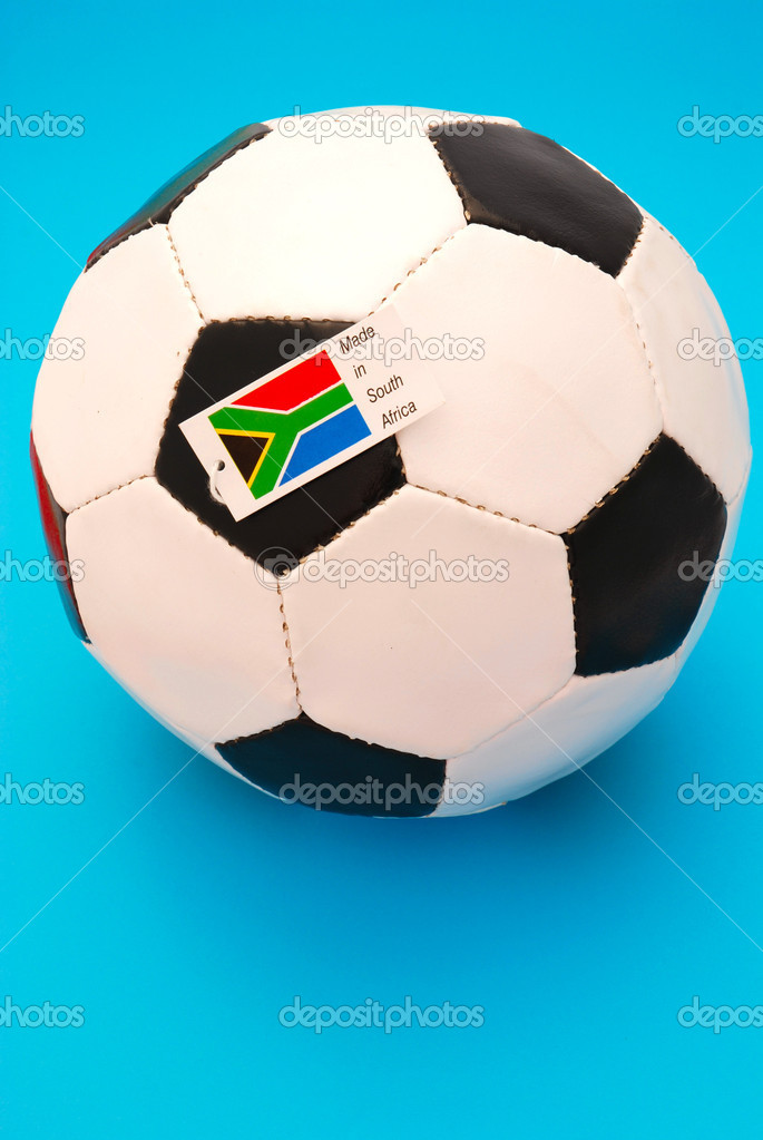 A traditional black and white soccer ball with tag MADE IN SOUTH AFRICA for the football world cup in 2010 on blue studio background — Stock Photo #6959163