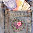 Money in blue jeans pocket - Stock Photo