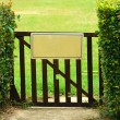 Blank sign on gate — Stock Photo #7087515