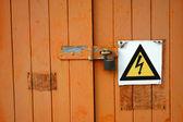 Wooden door with warning sign — Stock Photo