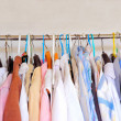 Stock Photo: Clothes on hangers