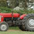 Tractor in red - Stock Photo