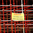 Scaffolding with danger sign — Stockfoto