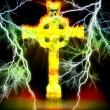 Celtic cross on fire with plenty of lightning - Stock Photo