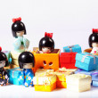 Asiatische figuren mit Geschenken - Stock Photo