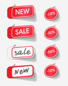 Sale and new red labels — Stock Vector
