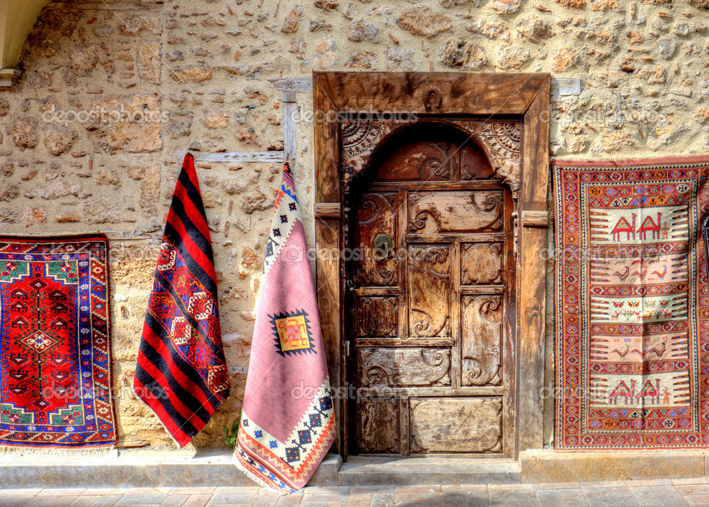 Carved ancient doorway of a shop in an old Mediterranean town.  Stock Photo #7009978