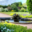 English garden scene with fountain — Stock Photo