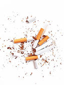 Various broken cigarettes and butts as a give up smoking concept — Stock Photo